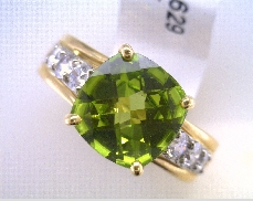 14k yellow gold ladies peridot and diamond ring containing one  10 mm Cushion Peridot and  0.73 c...