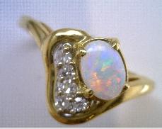 14 Karat Yollew Gold  Opal 0.15 Carat Total Weight Diamond Ring