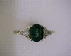 14kY 1.25ct Natural Emerald & 0.37ctw G-H I1 Trillion Diamond Ring