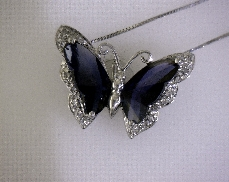 10kW Synthetic Sapphire & 0.08ctw G-H VS2-SI2 Diamond Butterfly Pendant with Chain