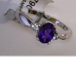 14 Karat White 7x5 0.68 ct Oval Amethyst 0.10 Carat Total Weight  Diamond Ring