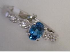 18 Karat Whitght Gold 0.69Carat Total Weight Oval Blue Zircon 0.06 Carat Total Weight Diamond Ring